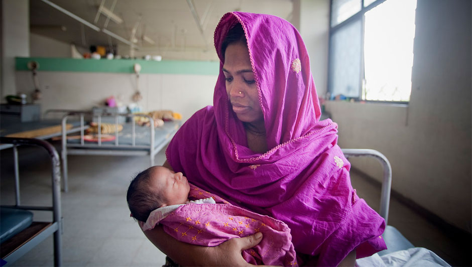 A mom and her newborn baby in Dhaka, Bangladesh.