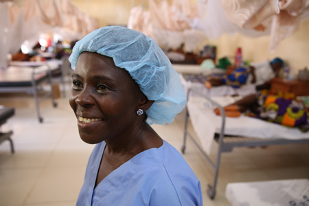 A portrait of Lucy Barh, a midwife at Redemption Hospital in Monrovia, Liberia