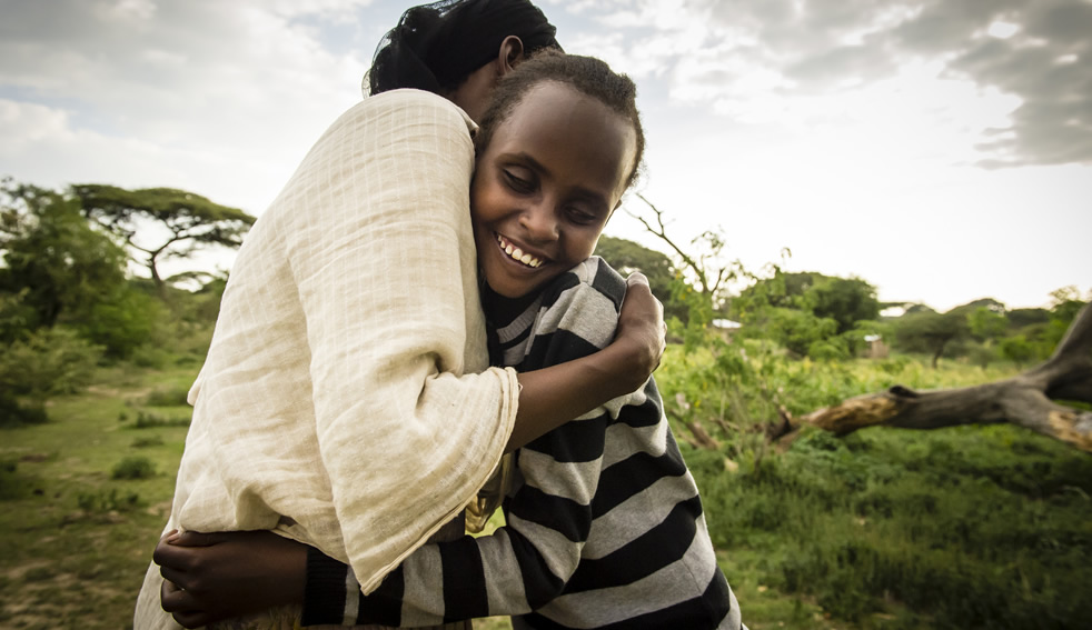 A mother and daughter embrace at Camp Langano, Ethiopia. Photo by Sean Sheridan.