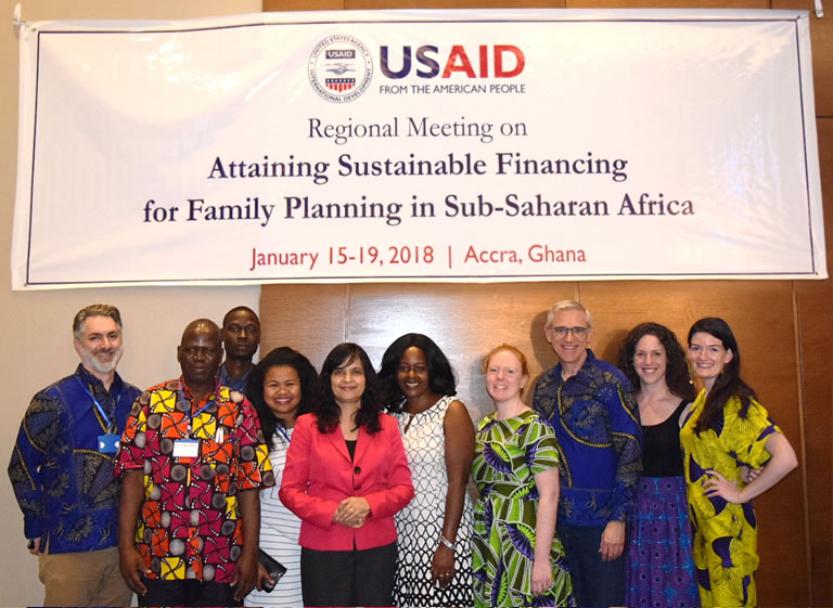 Group photo of HP+ presententers under the USAID meeting banner