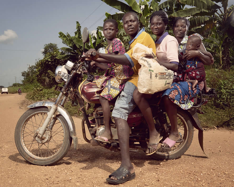 A family of 5 on a motor bike
